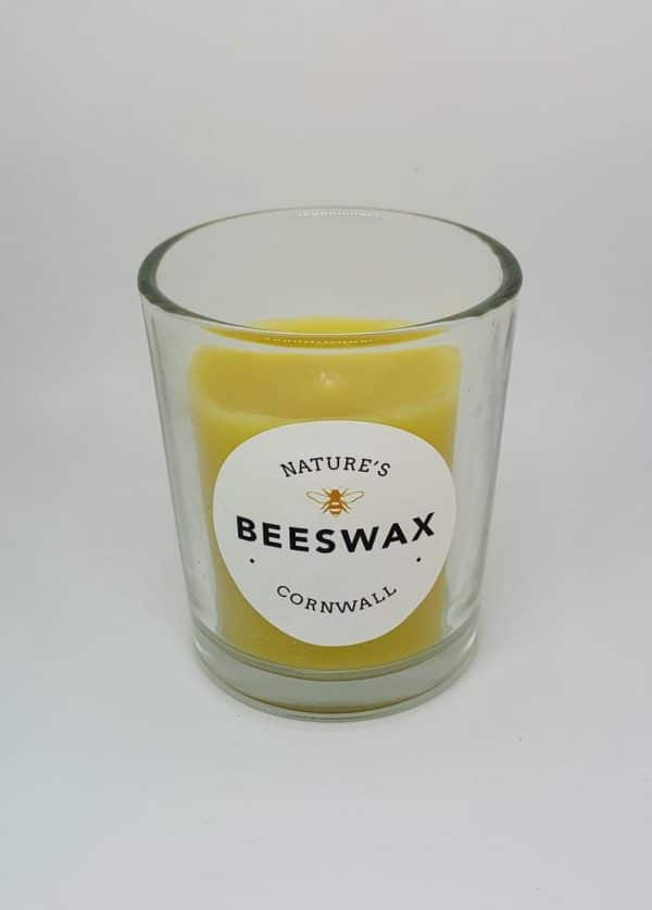image of beeswax candle in glass