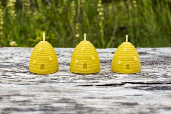 image of beeswax candles beehives